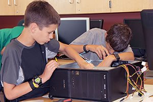 Two students learning computer repair in Learning Can Be Fun 2016 classroom.