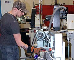 WCE machining student at welding facility