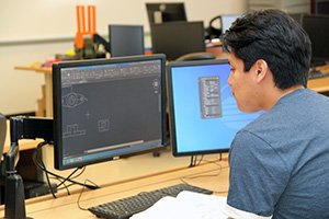 student in advanced technology center