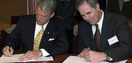 Dr. Lynn Rose, JMU President (l) and Dr. James Perkins (r) signing a Guaranteed Admissions Agreement in 2000.