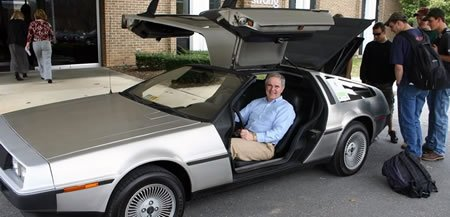 Dr. James Perkins sits in DeLorean donated for the Spring Fling Auction.