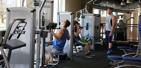 Students in the weight room of the rec center