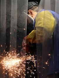 Student in welding facility