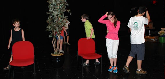 Students on stage in the Black Box Theatre