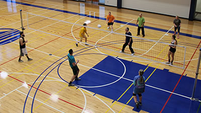 Students playing basketball in rec center