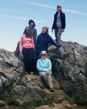 Faculty members Lynne Ryan, Hilary Campbell, Robin Hawks, Lisa Kara, and Maggie Marangione on top of mountain