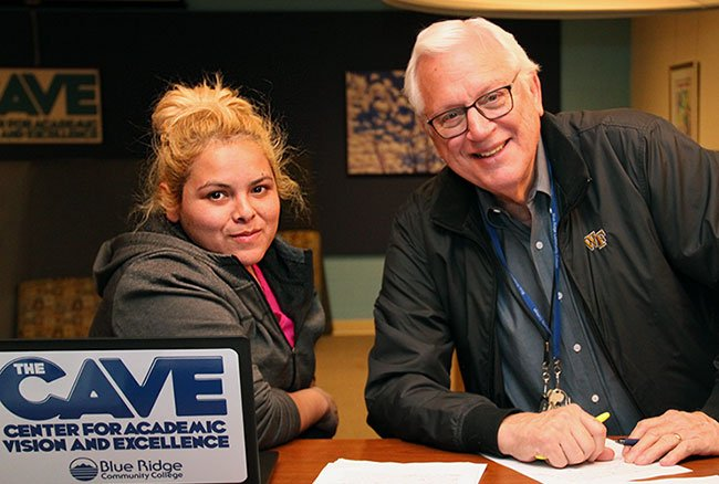 ESL instructor Bill Hopkins with Aracely Gonzalez in The C.A.V.E.