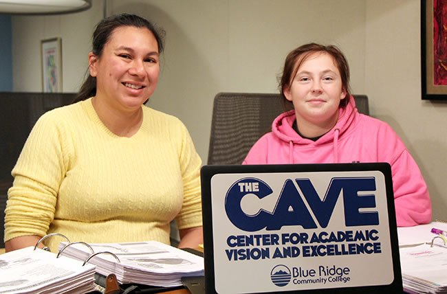 Peer Tutor Mayumi Smitka with Cheyenne Kennedy in The C.A.V.E.
