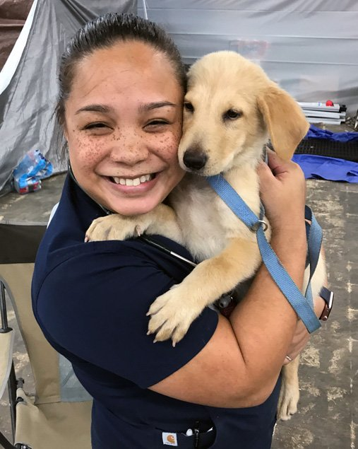 Jessie Griffin gives some puppy love.