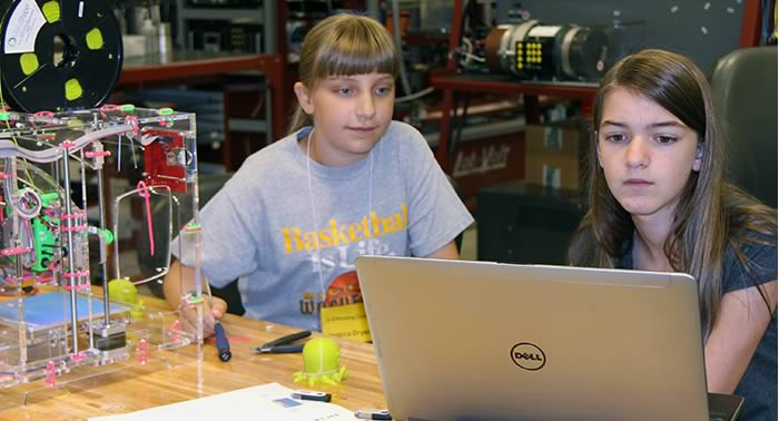 middle school students in technology workshop