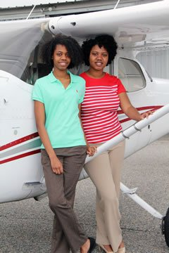 Sisters Motsarah (l) and Christiane (r) Caldwell by plane