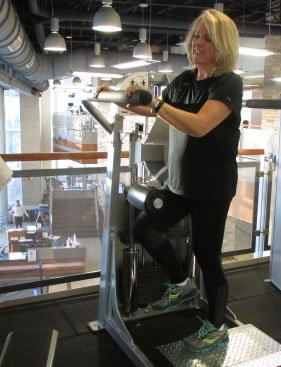 Donna Ladd working out in fitness center